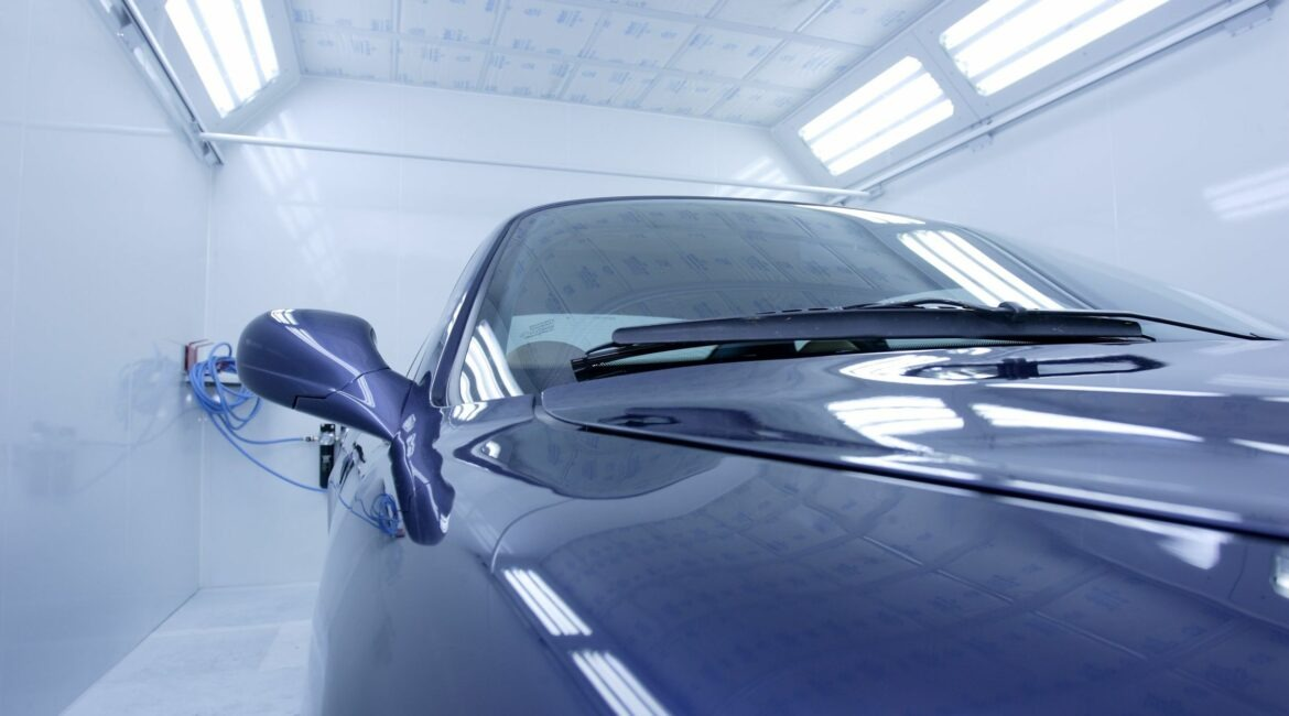 Blue car in spray booth